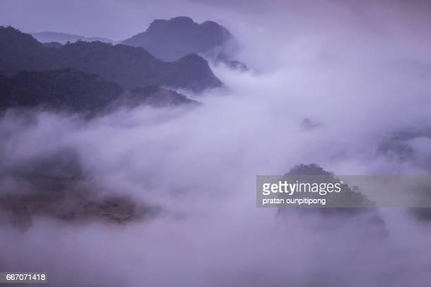 Morning fog over mountain peak