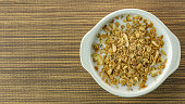 A Morning food almond flakes  and milk in white bowl on wood table.