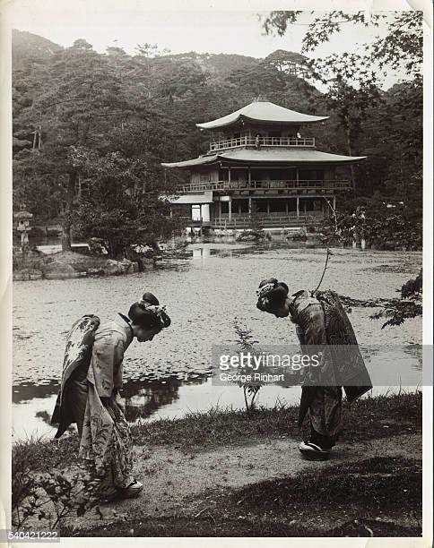 Morning greetings are given by the political people in the world on the grounds of the Golden Pavilion near Kyoto Japan