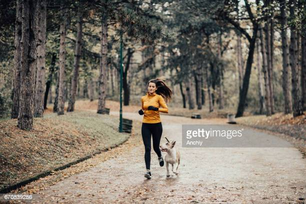 Morning jogging with the dog in the park