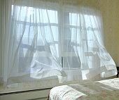Morning bringing a cool ocean breeze through my bedroom window.