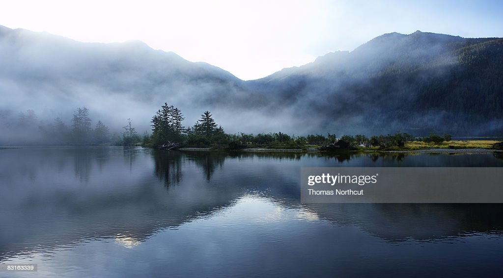 Morning light  and mist across sound and mountains : Stock Photo