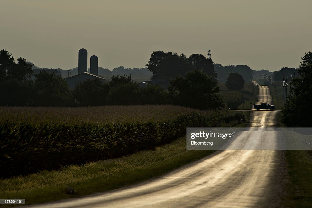 Morning light is reflected on a rural road outside of Sheffield, Illinois, U.S., on Wednesday, Aug. 28, 2013. Wheat futures fell for a third straight day on signs of slack demand for inventories from the U.S., the worlds largest exporter, while soybeans dropped and corn gained. Photographer: Daniel Acker/Bloomberg via Getty Images