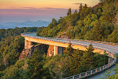 morning light spills out on the Lynn Cove viaduct along the Blue Ridge Parkway in North Carolina.
