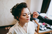 The morning make-up in the room for a beautiful bride