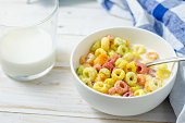 Morning meal, Colorful cereal with milk in white bowl
