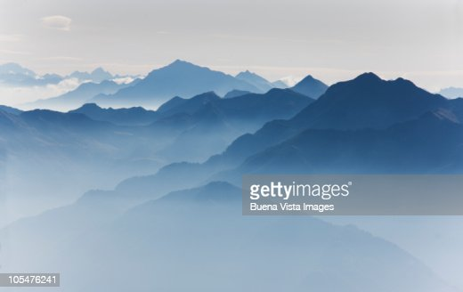 Morning mist in the swiss Alps  : Stock Photo