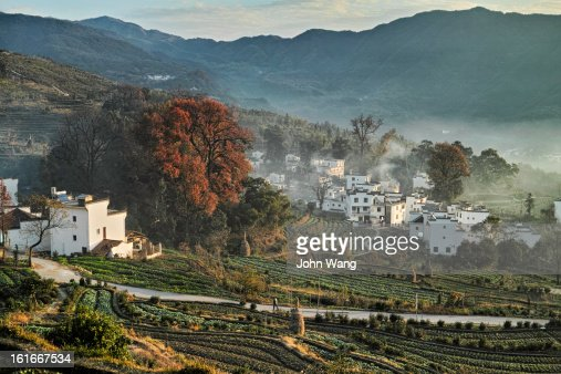 Morning mist over an ancient village in China