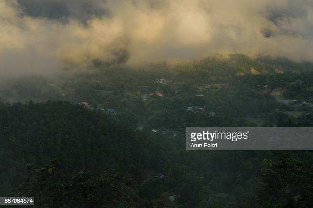 Morning mountain landscape with waves of fog at Mae Hong Son province, Northern Thailand. Waves of clouds in the background peaks covered with coniferous deciduous forests