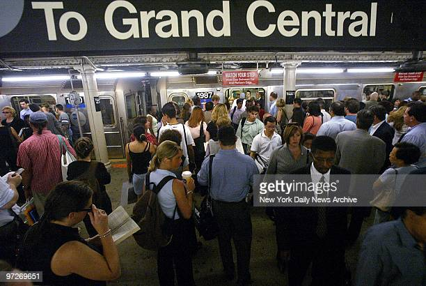 Morning rush hour passengers pack the platform at Grand Central subway station as they wait to board the shuttle train to Times Square Service was...
