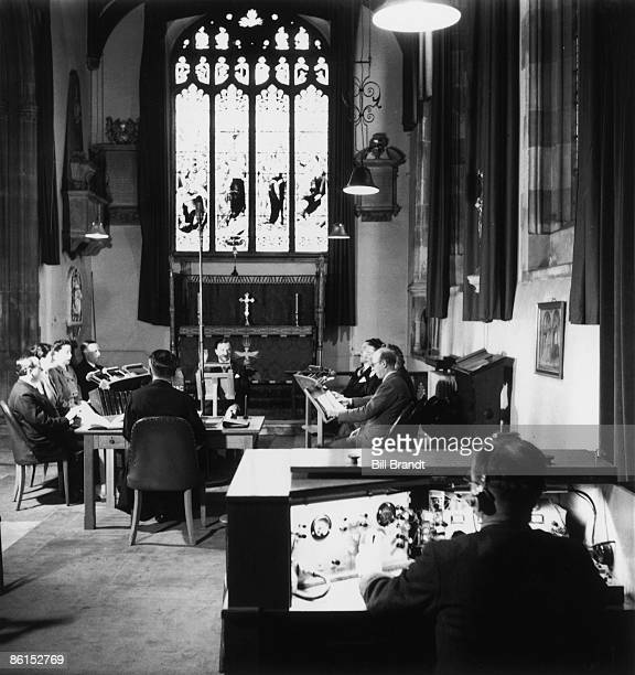 A morning service is broadcast from the BBC's own chapel in St Paul's Church Bedford 1945 Opposite the clergyman is Dr George ThalbenBall musical...