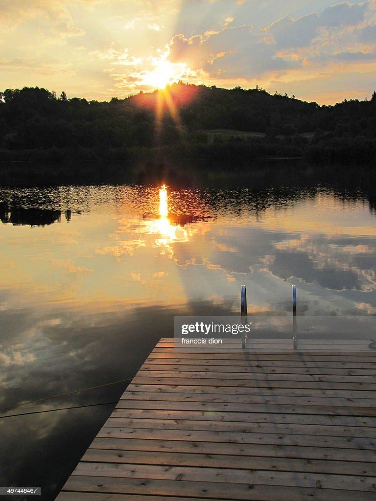 Morning sun rising on river