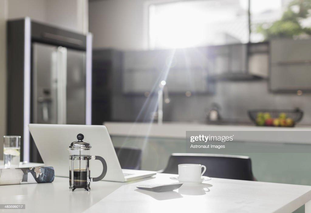 Morning sun shining on laptop in kitchen