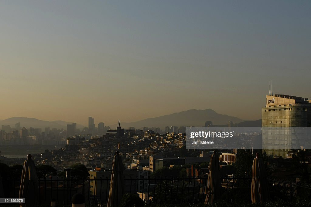 Morning sunlight illuminates residential properties north of the Han River backdropped by mountains and skyscrapers of the Gangnam business district on September 6, 2011 in Seoul, South Korea. The South Korean capital has a population in excess of 10 million with the wider metropolitan area being home to more than 20 million making it one of the largest in the world.