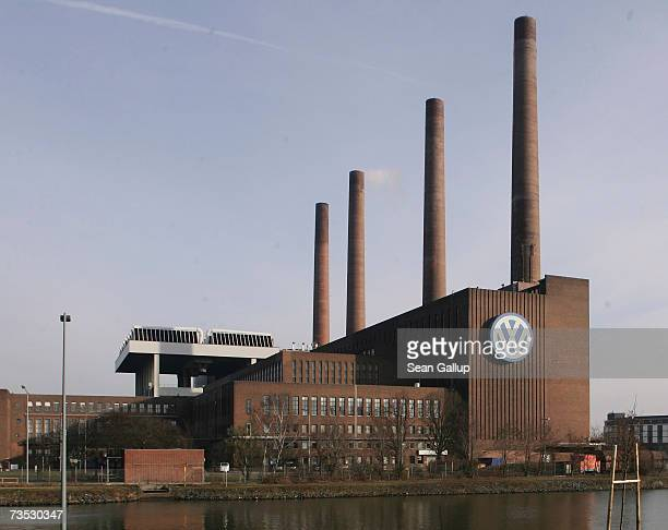 Morning sunlight shines on the Volkswagen logo at the German auto maker's main factory March 9 2007 in Wolfsburg Germany The company is scheduled to...