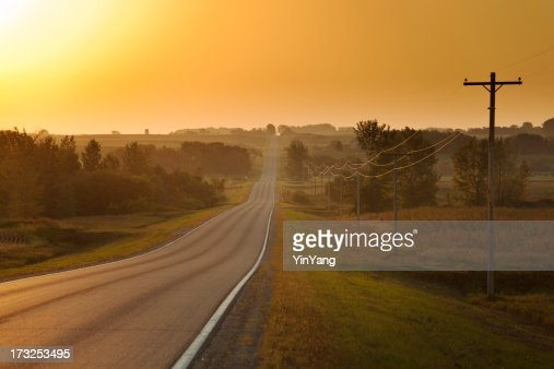 Morning Sunrise over Rural Farm Country Road