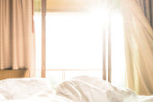 warm bed with sunshine from outside.
