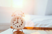 morning time background, alarm clock near the bed at home