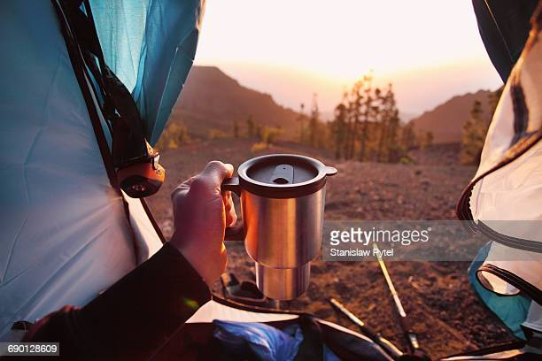 Morning view from tent, cup in hand