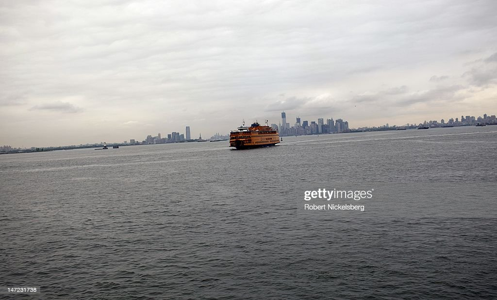 A morning view of a Staten Island Ferry heading away from New York City in the direction of Staten Island June 19, 2012. New York City's financial district lies in the background.