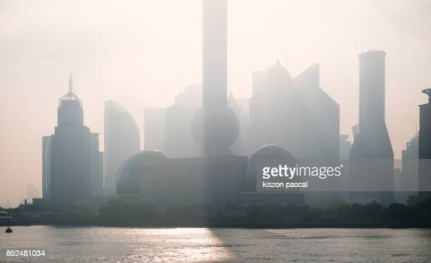 morning view of Lujiazui financial district in Shanghai with sunlight , China