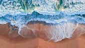 Top down aerial photograph capturing the ocean at Mornington Peninsula Beackbeach