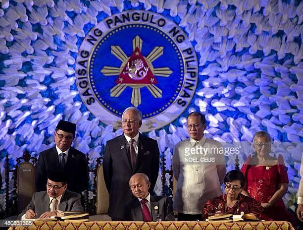 Moro Islamic Liberation Front Chairman Al Haj Murad Ibrahim Malaysian Prime Minister Najib Razak Peace Facilitator Tengku Dato Abdul Ghafar Tenku...