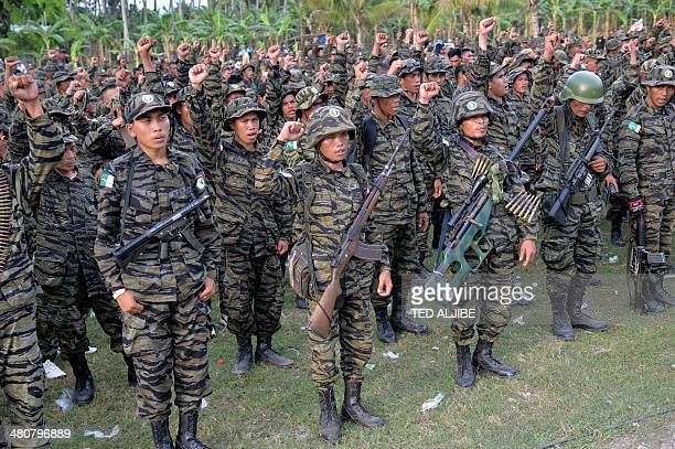 Moro Islamic Liberation Front rebels shout 'Allah akbar' while gathered inside their camp as thousands of members and local residents arrive for a a...