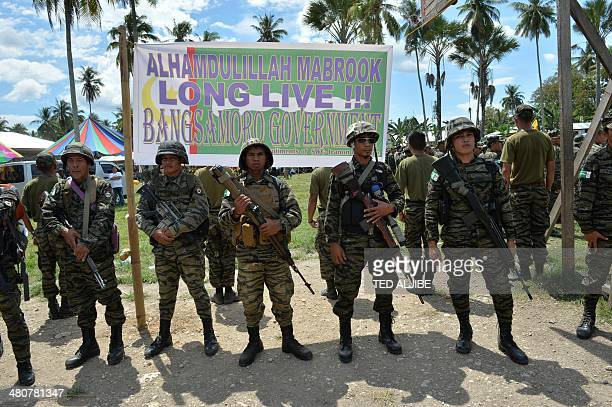 Moro Islamic Liberation Front rebels stand in formation inside their camp as thousands of its members and residents arrive for a rally in support of...