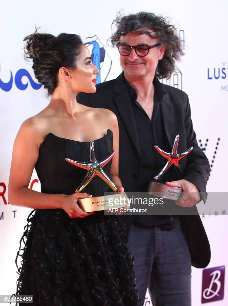 Moroccan actress Nadia Kounda poses with her 'Best Actress' award next to Lebanese director Ziad Doueiri during the closing ceremony of the ElGouna...