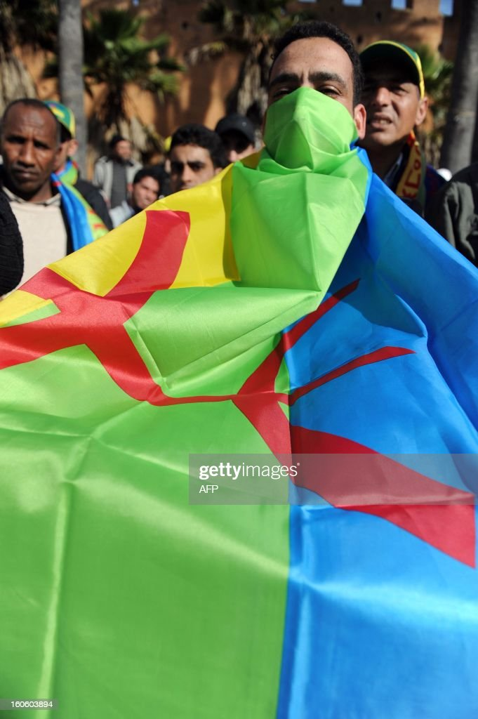 A Moroccan Amazigh Berber covers himself with the Amazigh flag during a protest calling for the release of political prisoners and demanding more rights in Rabat on February 3, 2013. Some 200 protesters took part in the demonstration which also denounced the presence of French military in Mali.