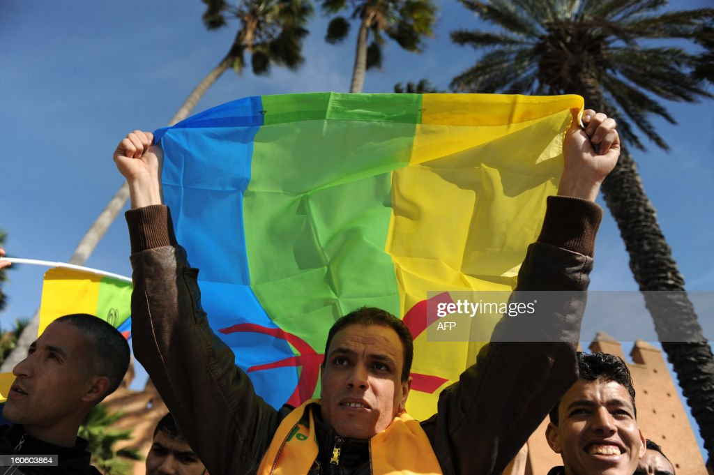 A Moroccan Amazigh Berber waves the Amazigh flag during a protest calling for the release of political prisoners and demanding more rights in Rabat on February 3, 2013. Some 200 protesters took part in the demonstration which also denounced the presence of French military in Mali. AFP PHOTO/FADEL SENNA