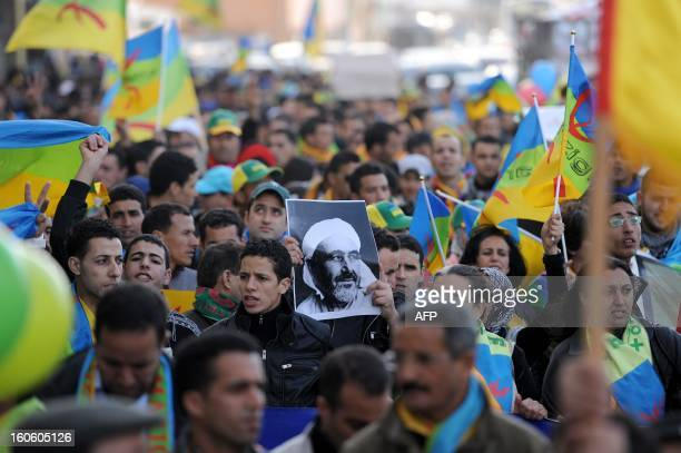 Moroccan Amazigh Berbers hold a picture of Abdelkrim Khattabi late leader of the Rif Rebellion against colonial rule during a protest calling for the...