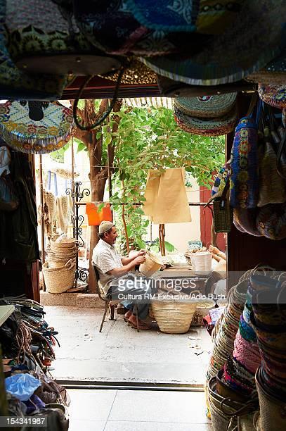 Moroccan artisan weaving basket