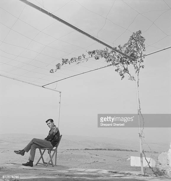 Moroccan author Mohammed Mrabet relaxes at the home of American author and composer Paul Bowles in Tangier Morocco