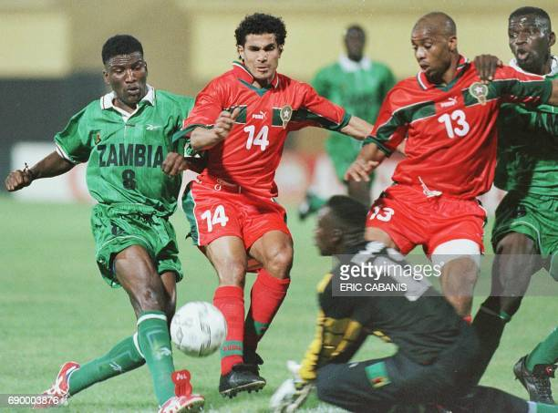 Moroccan Bassir Salaheddine and Bajha Ahmed struggle with Zambian goalkeeper Phiri Davies and defender Chongo Harrisson during their 1998 African...