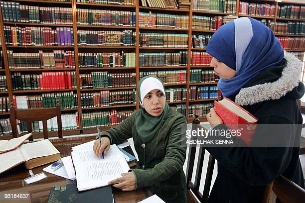 Moroccan female students studying islamic theology read 22 December 2005 in the library of Dar elHadith elHasania theological faculty in Rabat AFP...