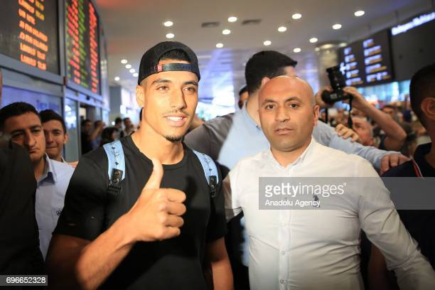 Moroccan footballer Nabil Dirar gestures as he arrives at Ataturk International Airport in Istanbul Turkey on June 16 2017 Nabil Dirar was welcomed...