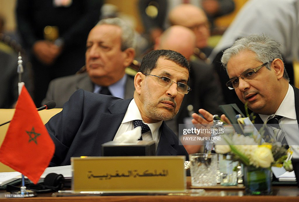 Moroccan Foreign Minister Saad-Eddine El Othmani (L) listens to his aide during the meeting of the Arab Foreign Ministers on the eve of the third session of the Arab Economic, Social and Development Summit held in Riyadh on January 19, 2013. Saudi Arabia is due to host the Arab Economic summit for the leaders on January 21 and 22.