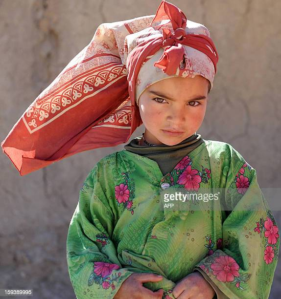 A Moroccan girl stands outside her home in Anfgou in the High Atlas mountains on January 12 2013 More than 20 tons of food and hundreds of duvets and...