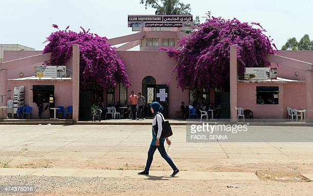 Moroccan girl walks in front of the Dhar ElMehraz campus at the University of Fez on May 13 2014 which some students claim is one of the last...