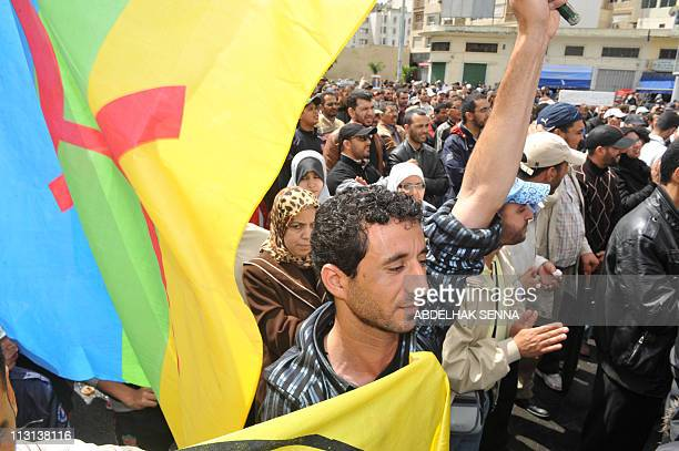 A Moroccan holding a Berber flag demonstrates in Casablanca on April 24 2011 to appeal for a more open democratic political system Even with the...