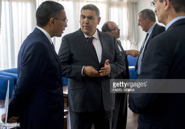 Moroccan Interior Minister Abdelouafi Laftit and Governor of the Northern Region Mohamed El Yaakoubi speak following a meeting on june 12 2017 in the...