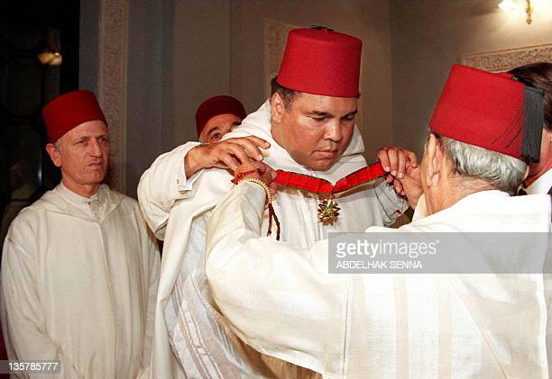 Moroccan King Hassan II decorates former World Heavyweight Champion Muhammad Ali in a ceremony in the Royal Palace in Rabat 15 January The former...