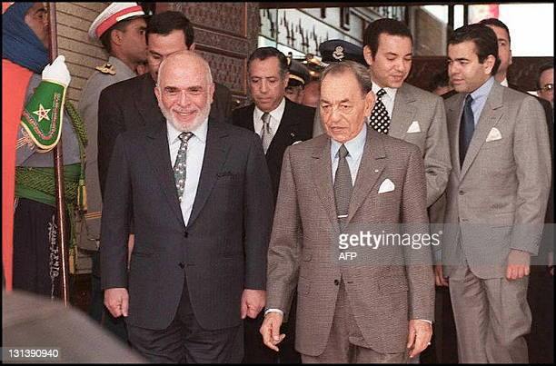 Moroccan King Hassan II escorts Jordanian monarch Hussein 18 February in Rabat at the start of his twoday official visit to discuss the Middle East...