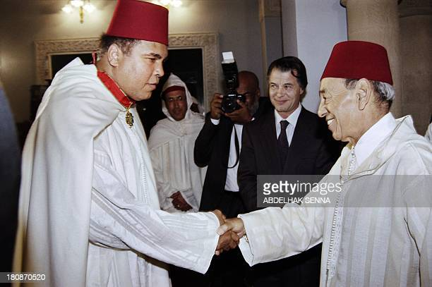 Moroccan King Hassan II salutes former World Heavyweight Champion Muhammad Ali after decorating him in a ceremony in the Royal Palace in Rabat on...
