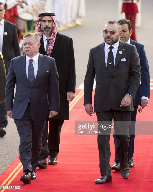 Moroccan King Mohamed VI and Jordanian King Abdullah II arrive for a welcome ceremony at the Royal Palace in Rabat on March 22 2017 / AFP PHOTO /...