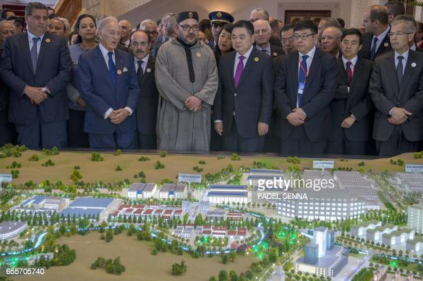 Moroccan King Mohamed VI and Li Biao Chairman of the Chinese group Haite attend the launch of a Chinese investment project in Morocco on March 20 at...