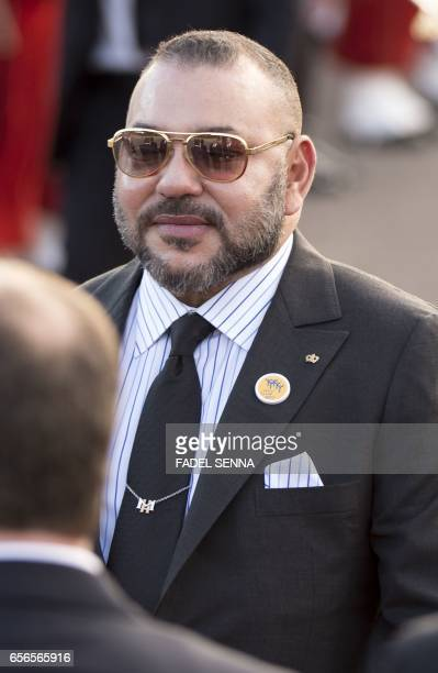 Moroccan King Mohamed VI is seen during a welcome ceremony for the arrival of the Jordanian King at the Royal Palace in Rabat on March 22 2017 / AFP...