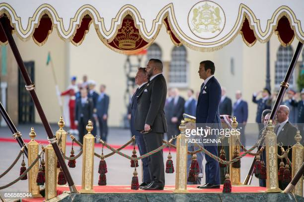Moroccan King Mohamed VI Prince Moulay Rachid and Jordanian King Abdullah II review the honour guard during welcome ceremony at the Royal Palace in...
